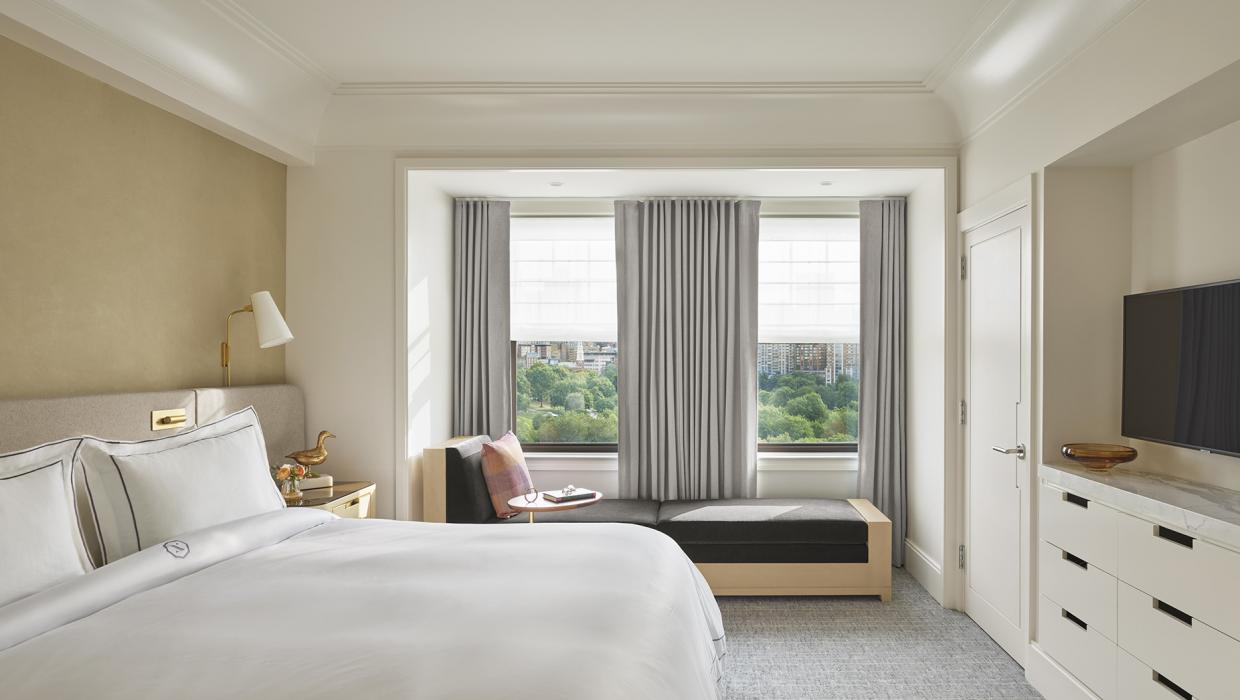 view of bedroom with double windows overlooking park