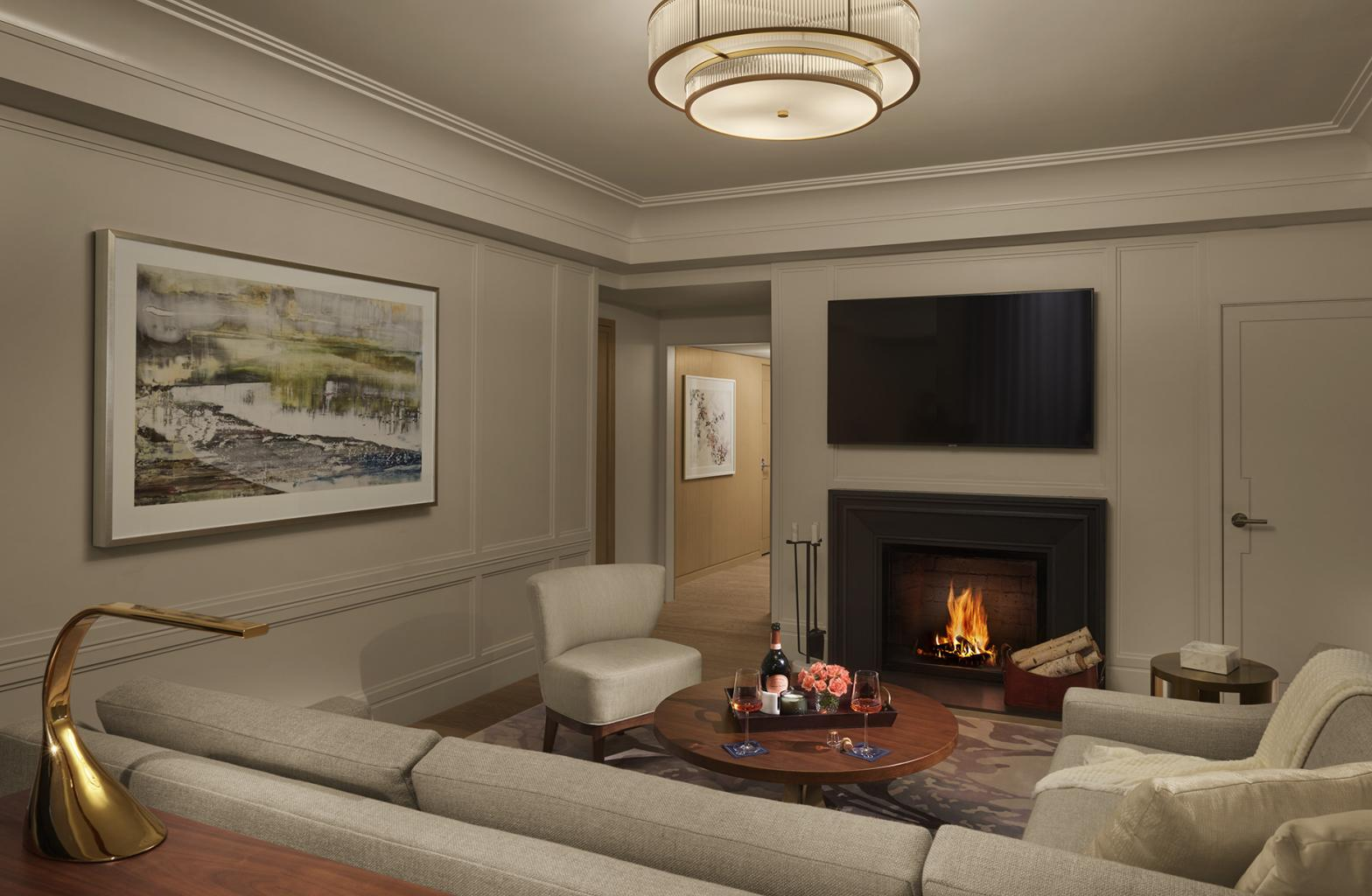 fireplace lit in dim living room area